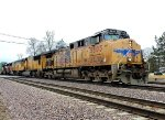 UP 5605 east with a long stack train and a Ferromex unit trailing